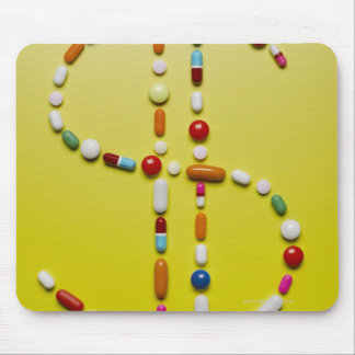 Assorted pills creating dollar symbol mouse mat