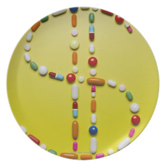 Assorted pills creating dollar symbol plate