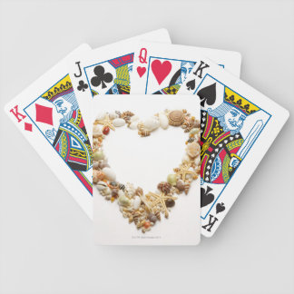 Assorted seashells form heart shape bicycle playing cards
