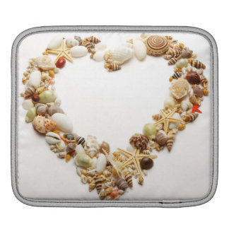 Assorted seashells form heart shape iPad sleeve