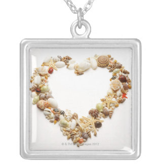 Assorted seashells form heart shape silver plated necklace