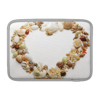 Assorted seashells form heart shape sleeve for MacBook air