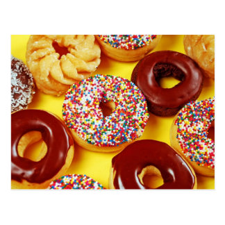 Assortment of fresh tasty donuts postcard