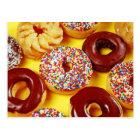 Assortment of fresh tasty doughnuts postcard