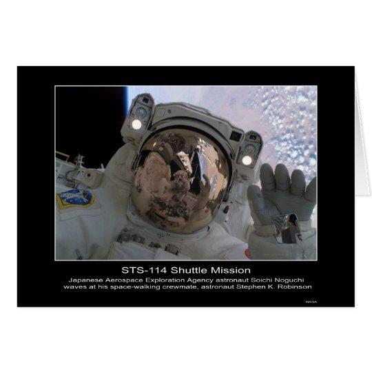 Astronaut Soichi Noguchi waves at astronaut Stephe Card