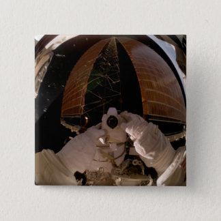 Astronaut uses a digital still camera 15 cm square badge