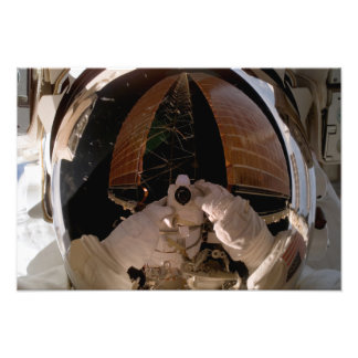Astronaut uses a digital still camera photo print