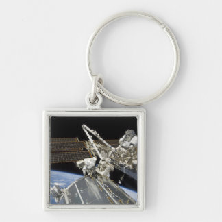 Astronauts perform a series of tasks Silver-Colored square key ring