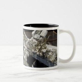 Astronauts perform a series of tasks Two-Tone coffee mug