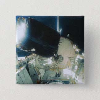 Astronauts Repairing a Satellite in Space 15 Cm Square Badge