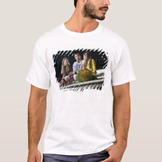Athletes on bleachers T-Shirt