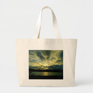 Atmospheric cloudy sky green blue white tote bags