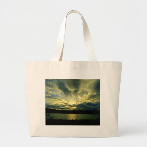 Atmospheric cloudy sky, green, blue, white tote bags