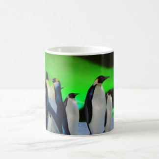 Aurora borealis and penguins coffee mug