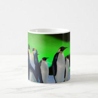 Aurora borealis and penguins coffee mug