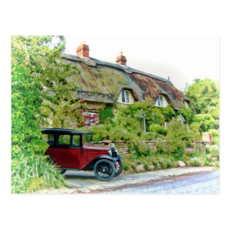 Austin 7 outside a thatched cottage postcard