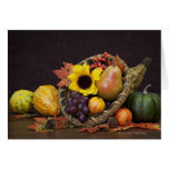Autumn cornucopia with grapes, pear and gourds