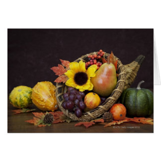 Autumn cornucopia with grapes, pear and gourds card
