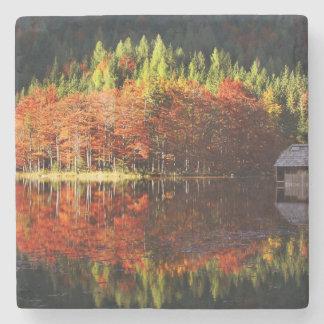Autumn landscape on a lake stone coaster