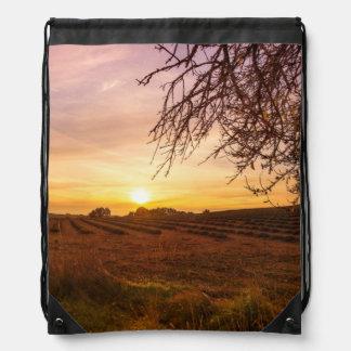 Autumn lavender field on sunset drawstring bag
