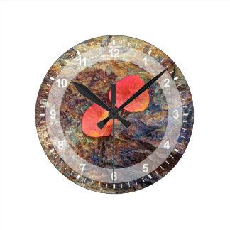 Autumn leaf on rock, California Round Clock