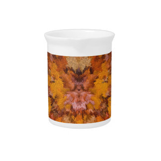 Autumn leaves in abstract beverage pitcher
