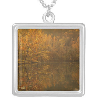 Autumn reflections on pond. silver plated necklace