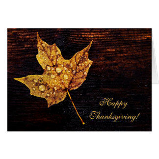 autumn yellow leaf with rain drops greeting card