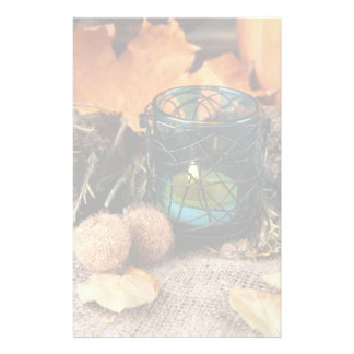 Autumnal composition with candle and leaves customized stationery