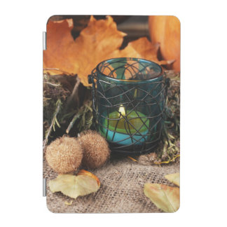 Autumnal composition with candle and leaves iPad mini cover