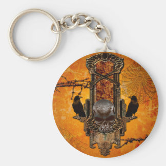 Awesome skulls and crow on a button with roses key ring