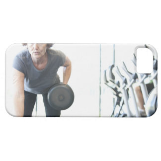 Baby boomer woman working out triceps in health case for the iPhone 5