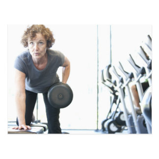Baby boomer woman working out triceps in health postcard