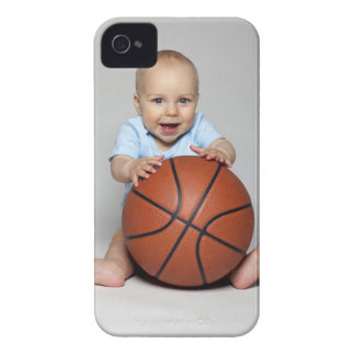 Baby boy (6-9 months) holding basketball, iPhone 4 cover