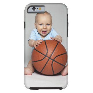 Baby boy (6-9 months) holding basketball, tough iPhone 6 case