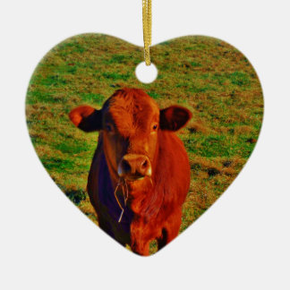 BABY BROWN COW EATING CERAMIC HEART DECORATION