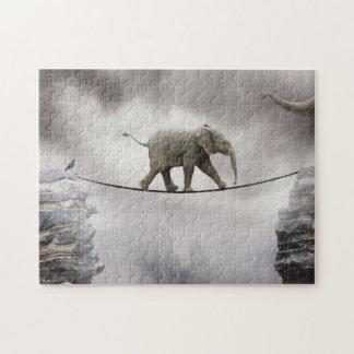 Baby elephant walks tightrope across big gorge. jigsaw puzzle