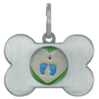 baby feet in blue pet ID tags
