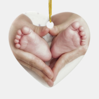Baby feet in mother hands christmas ornament