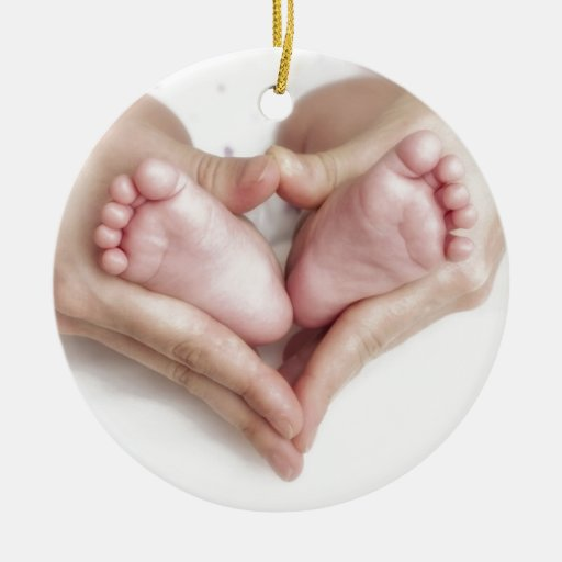 Baby feet in mother hands round ceramic decoration zazzle for Baby feet decoration