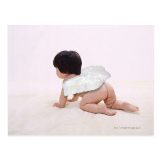 Baby girl in angel wings, smiling, rear view postcard