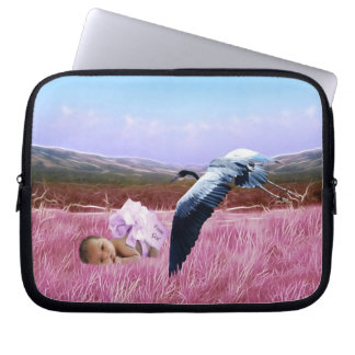 Baby girl in pink laptop computer sleeves