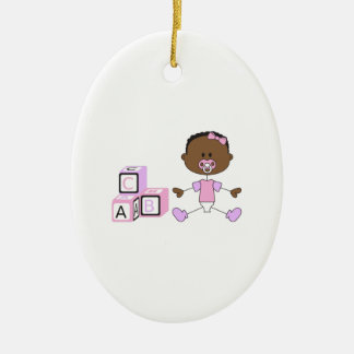 BABY GIRL WITH BUILDING BLOCKS CERAMIC OVAL DECORATION