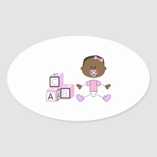 BABY GIRL WITH BUILDING BLOCKS OVAL STICKER