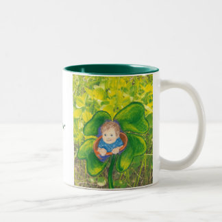 Baby in a clover field. Two-Tone coffee mug