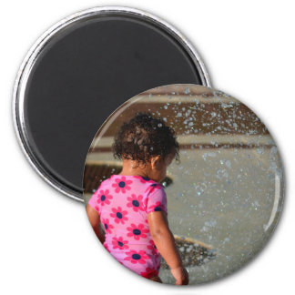 baby in pink one sie in fountain magnets