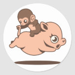 Baby Monkey (Going Backwards on a Pig) Round Sticker