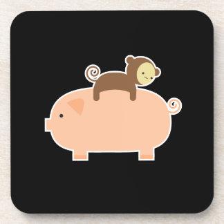 Baby Monkey Riding Backwards on a Pig Coaster