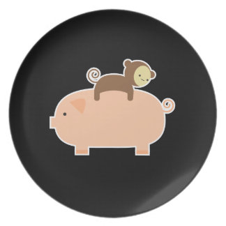 Baby Monkey Riding Backwards on a Pig Plate