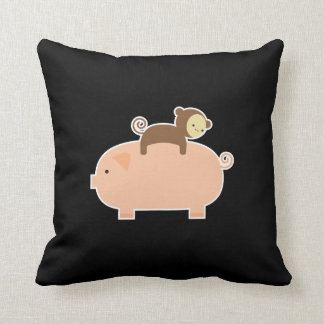 Baby Monkey Riding on a Pig Cushion